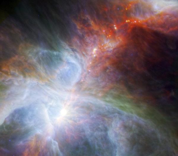 بعض النجوم المولودة حديثاً في كوكبة أوريون التي تبعد عن الأرض 1344 سنة ضوئية. حقوق الصورة: ESA/NASA/JPL-Caltech/N. Billot (IRAM) via AP