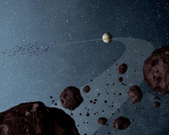 تصور فني لكوكب المشتري وبعض كويكبات طروادة بالقرب من الكوكب الغازي العملاق. الحقوق: NASA/JPL-Caltech