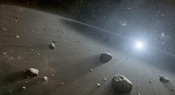 صورة فنية لقرص من الغاز والغبار المحيط بنجمٍ بعيد. هذه الأقراص شائعة حول النجوم الصغيرة، ويصعب رصدها. حقوق الصورة: NASA/JPL
