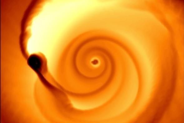 محاكاة رقمية لدوران ثقبين أسودين هائلين محاطين بقرص من الغاز   حقوق: Adapted from Farris et al. 2014