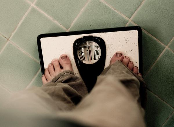 وزنك يعتمد على كتلتك على الأرض. Flickr/Stephanie Sicore, CC BY