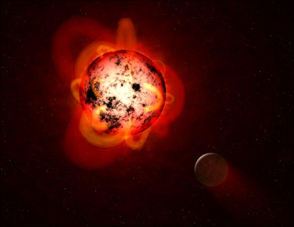 يبين هذا الرسم التوضيحي نجماً قزماً أحمر يدور حوله كوكب خارجي افتراضي  حقوق الصورة: (NASA/ESA/G. Bacon (STScI.