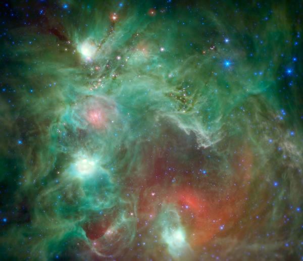 تظهر في هذه الصورة الملتقطة بالأشعة تحت الحمراء أعداد ضخمة من النجوم الوليدة وهي مغطاة بالغبار في منطقة التشكل النجمي NGC 2174، حيث التقطها تلسكوب سبيتزر التابع لناسا. تبدو بعض السُّحب في المنطقة مثل وجه قرد في الصور الملتقطة بالأشعة المرئية، ولذلك فقد سمي هذا السديم بسديم رأس القرد. المصدر: Credits: NASA/JPL-Caltech