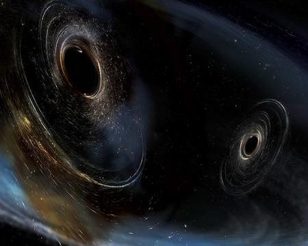 محاكاة فنية لاندماج ثقبين أسودين مثل اللذَين اكتشفهما مرصد لايغو. يدور الثقبان بطريقة غير متراصفة، مما يعني أن لديهما اتجاهات مختلفة بالنسبة للحركة المدارية الإجمالية للأزواج. وجد لايغو إشارات تدل بأن ثقباً أسود واحداً على الأقل ويدعى بـ GW170104 كان غير متراصف مع حركته المدارية قبل أن يندمج مع ندّه.     حقوق الصورة: LIGO/Caltech/MIT/Sonoma State) Aurore Simonnet)