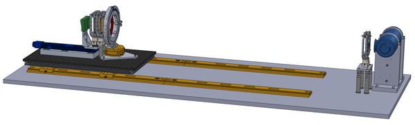 يوضع جهاز تصوير الأطوار المختلفة بالأشعة السينية الخاص بمختبرات سانديا الوطنية على طاولة الاختبار، ويوجد حاجزٌ شبكيٌ أمام أنبوب الأشعة السينية على اليمين مشكلًا صفوفًا منتظمةً من الأشعة التي تعبر إلى العينة الموجودة في الحلقة. وخلف العينة يوجد الحاجز الشبكي المحلّل والكاشف. Credit: Sandia National Laboratories