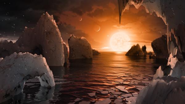 يسمح لنا هذا التصوّر الفني لتيم بايل بتخيُّل كيف سيكون المشهد لدى الوقوف على سطح الكوكب الخارجي ترابيست-1 إف الموجود في نظام ترابيست-1 في كوكبة الدلو. Credits: NASA/JPL-Caltech