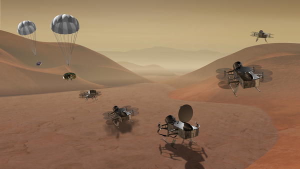 """طائرة دراغون فلاي """"Dragonfly"""" عبارة عن مروحية رباعية ذات هبوط مزدوج من شأنها الطيران إلى مواقع متعددة في قمر تيتان على بعد مئات الأميال لأخذ عينة من المواد، وذلك لتحديد مكونات سطح القمر تيتان، بالإضافة لدراسة الكيمياء العضوية للقمر ومدى استدامتها، ورصد ظروفه الجوية والسطحية، أيضاً أخذ صورة لتشكلات سطحه، ودراسة العمليات الجيولوجية، وإجراء الدراسات الزلزالية. المصدر: ناسا"""