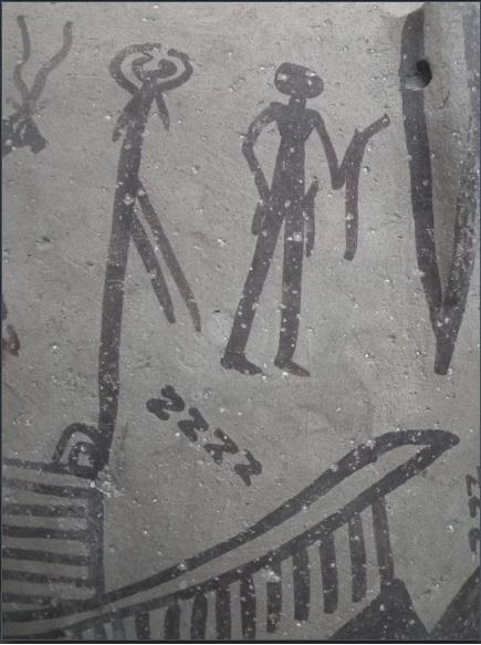 صورة طقس عشائري مرسومة على جرة فخارية من عصر ما قبل الأسرات. لاحظ الخطوط ذات شكل S (التي تبدو كحرف z) والشيء الطولي المُقوس بيد الرجل.