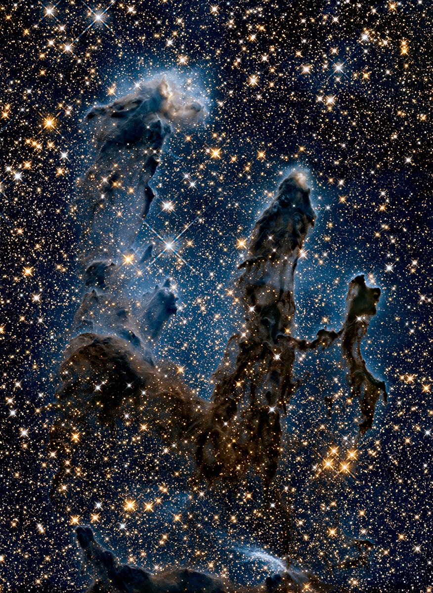 صورة بالأشعة تحت الحمراء لسديم النسر. حقوق الصورة: NASA, ESA, and the Hubble Heritage Team (STScI/AURA)